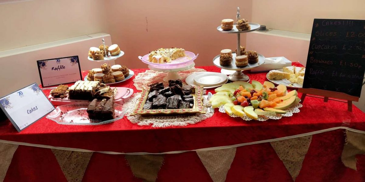 A table of cake and fruit