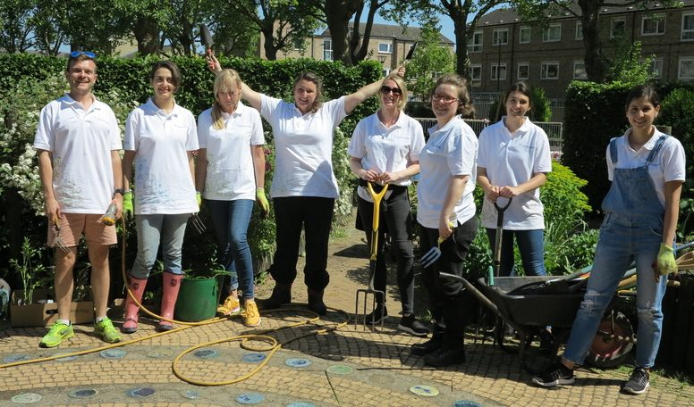 Group of corporate volunteers gardening at the Bromley by Bow Centre