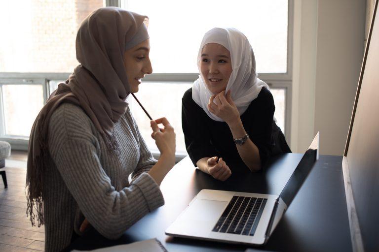 ESOL students at a computer